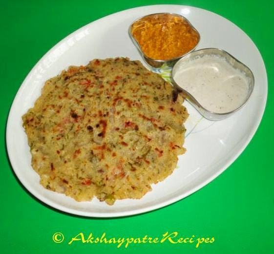 rava uttapa with chutney in a serving plate