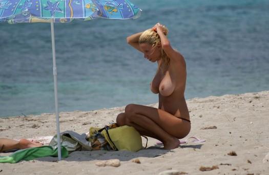 Big boob girl topless on beach