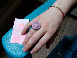 pink braided bracelet and lavender cabochon button ring
