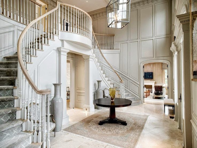 huge traditional white foyer wall paneling