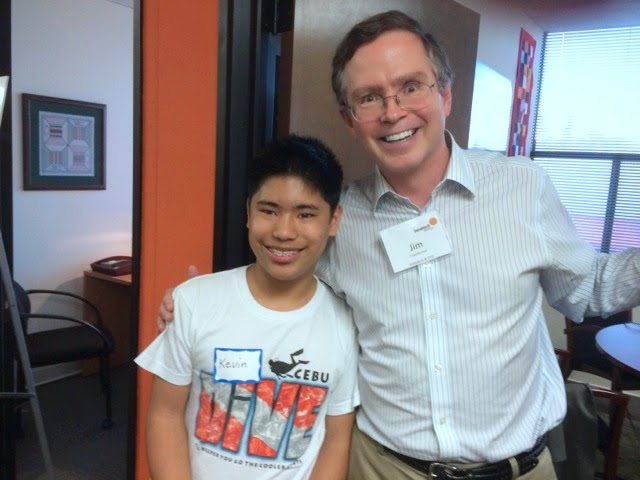 Benetech CEO Jim Fruchterman and Bookshare member Kevin Leong posing to the camera, smiling, at Benetech's offices.
