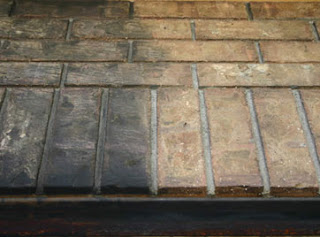 how to clean fireplace soot from brick