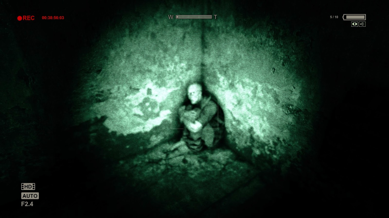 Outlast pc game review picture of man huddled in corner in nightvision mode