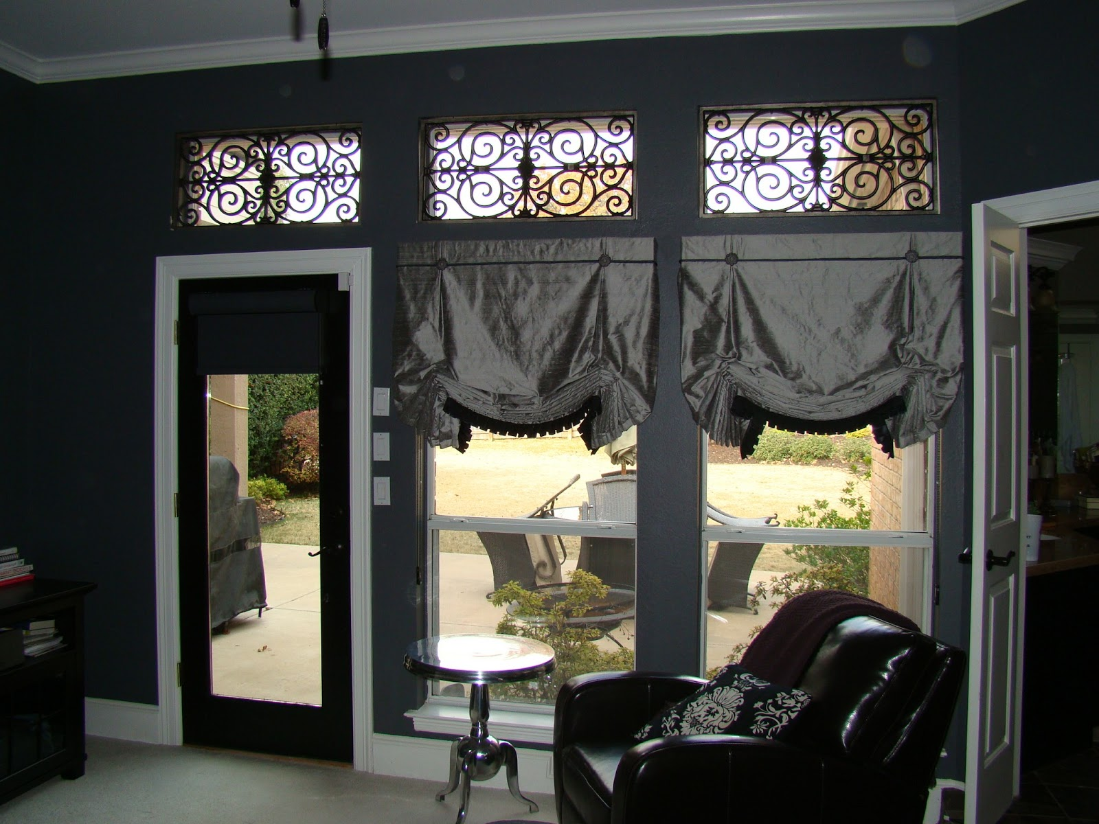 Simple Roller shades in the same charcoal color for privacy and light control Of course we added the faux iron in a pewter finish for the perfect accent in the