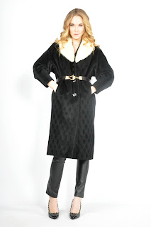 Vintage 1960's black wool swing coat with white fur trim.