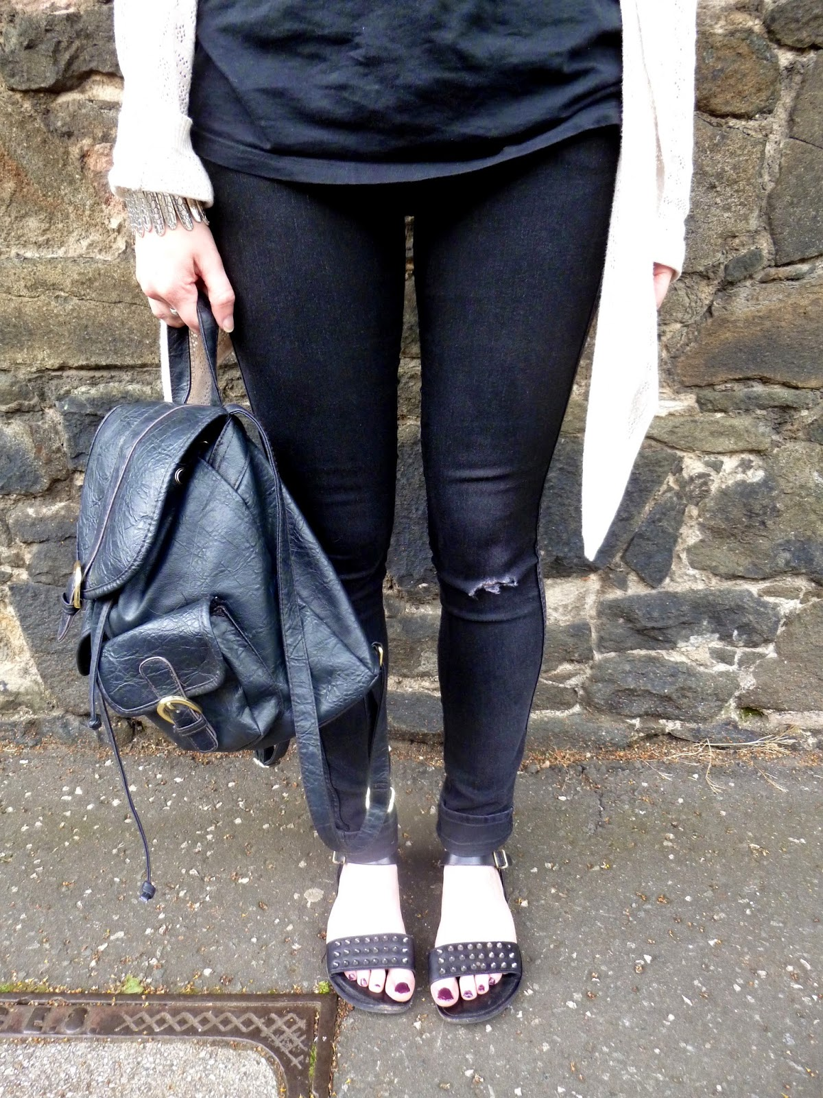 Details of todays outit with ripped jeans, studded sandals and lack leather rucksack