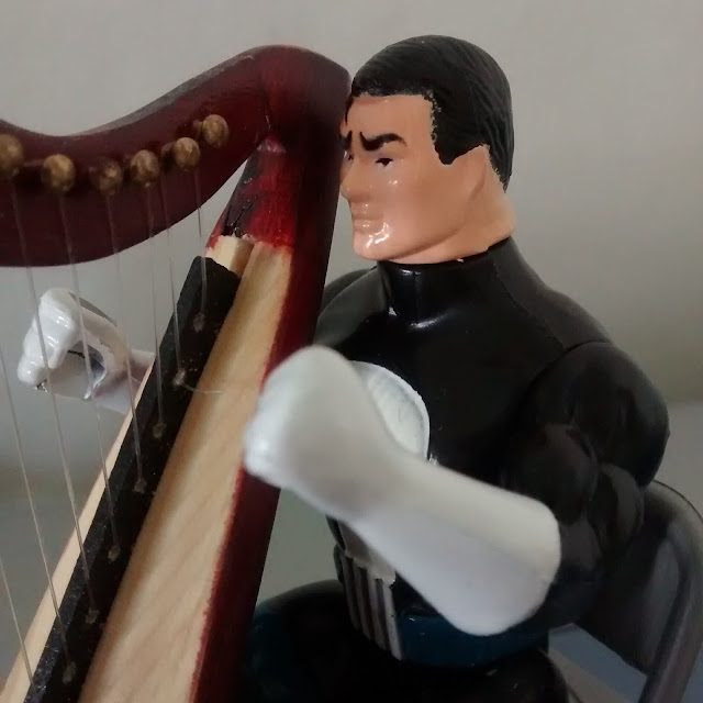 Talking Frank Castle enjoying his new harp.