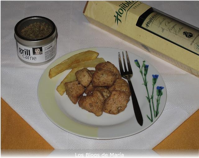 Dados de pechuga de pollo especiado