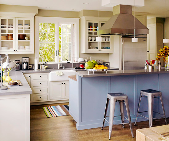Unite adjacent areas to the kitchen by repeating a color or motif. An ...