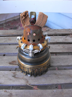 Theresa Fine's Tiny metal creature available in her etsy shop Ouida's Trunk
