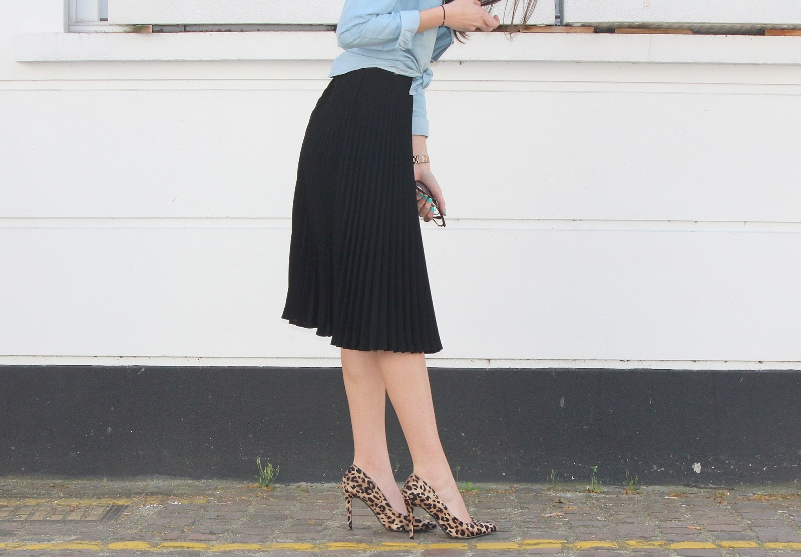 peexo fashion blogger wearing pleated midi skirt with lace bralet and denim shirt and leopard print heels in spring