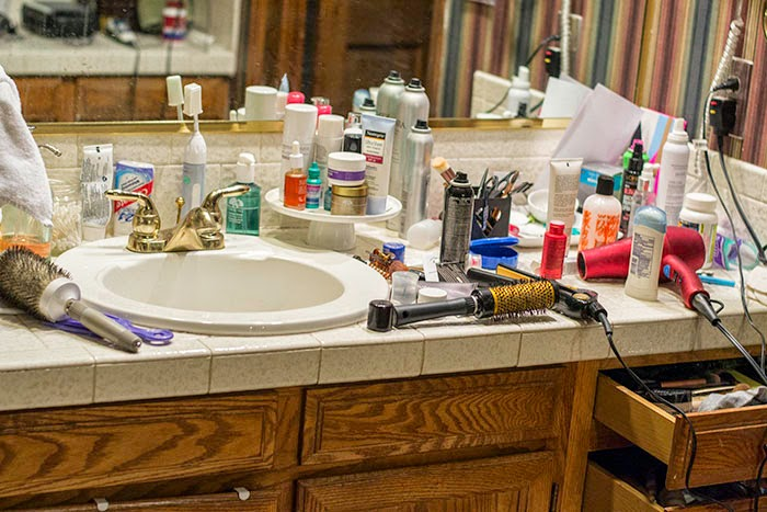 vanity organizing tips, how to organize your vanity, clearing the clutter on your vanity, striped wallpaper bathroom, use what you have, makeover