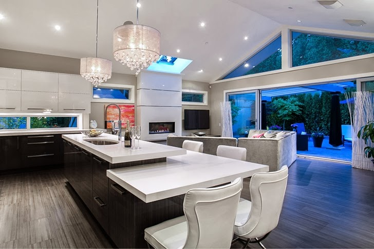 Kitchen island in Contemporary home by Trevor Euley in Canada