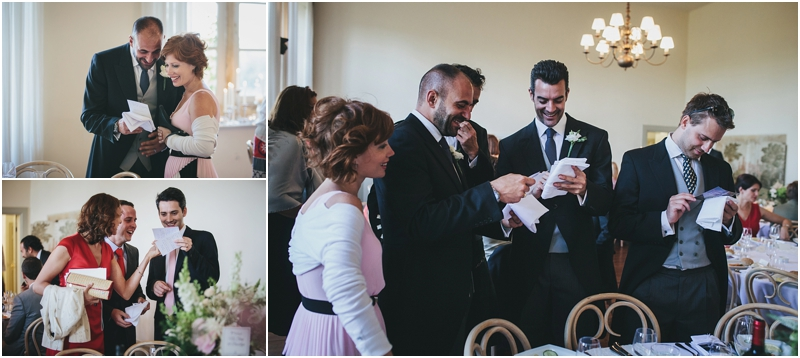 Guests laughing at photographs