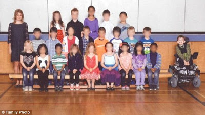Miles Ambridge left out of class photo