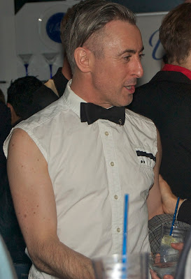 Alan Cumming going fashionably sleeveless