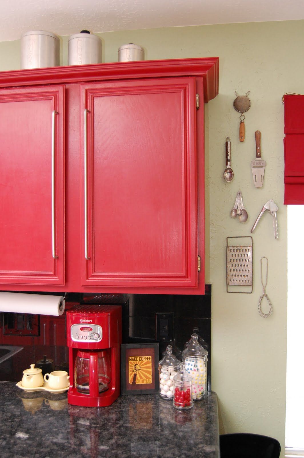 decorated my kitchen with some old kitchen utensils, cans, tools, etc