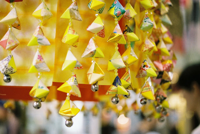 bright yellow tanabata decorations with many bells