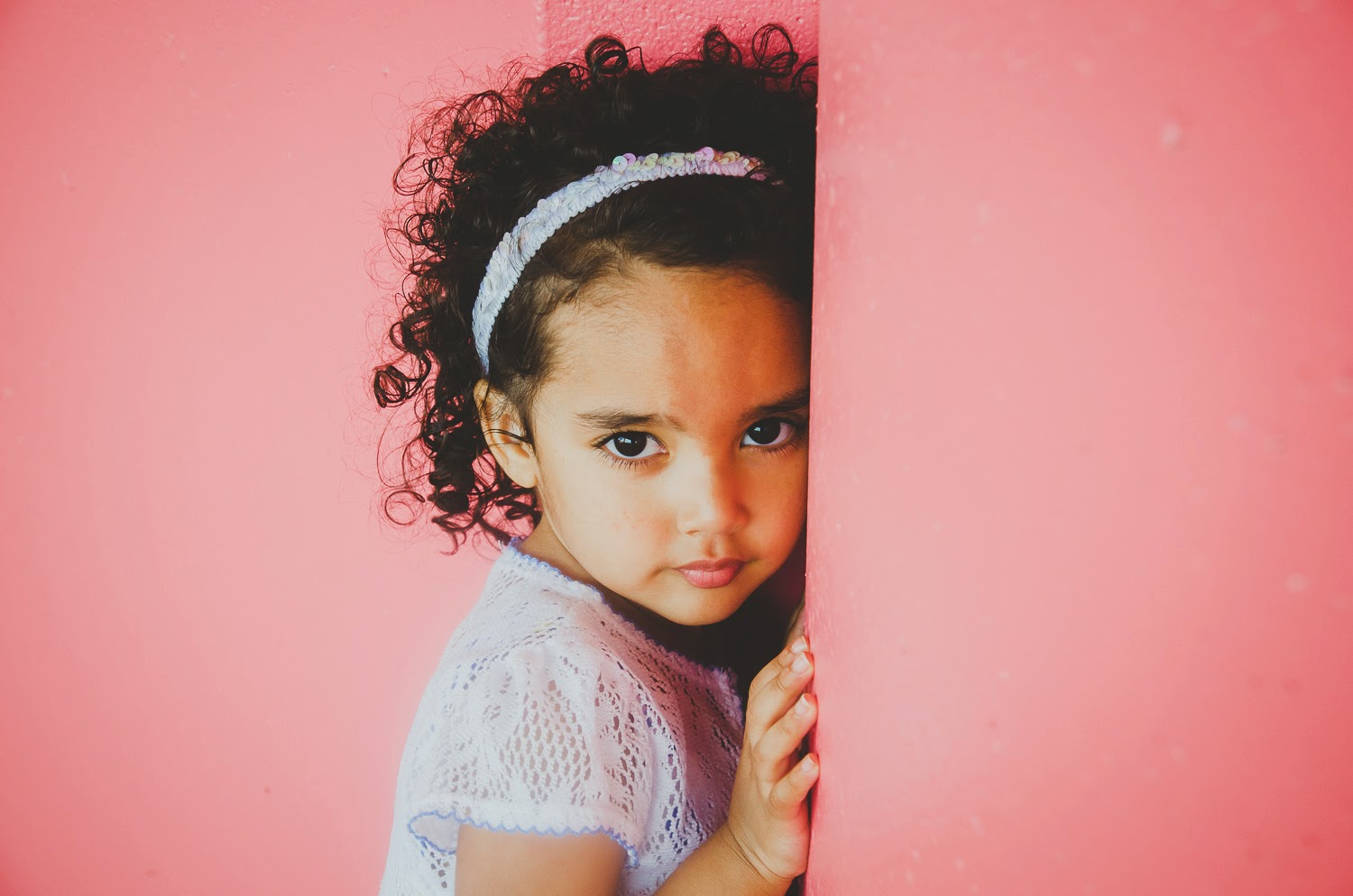 cute picture of a girl on a pink background in indianapolis, fishers, carmel