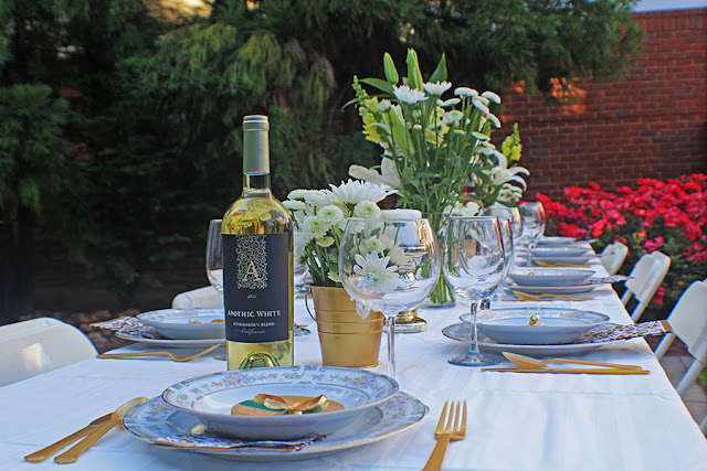 wine, flowers and placesetting outdoor dinner party | Cordier Events