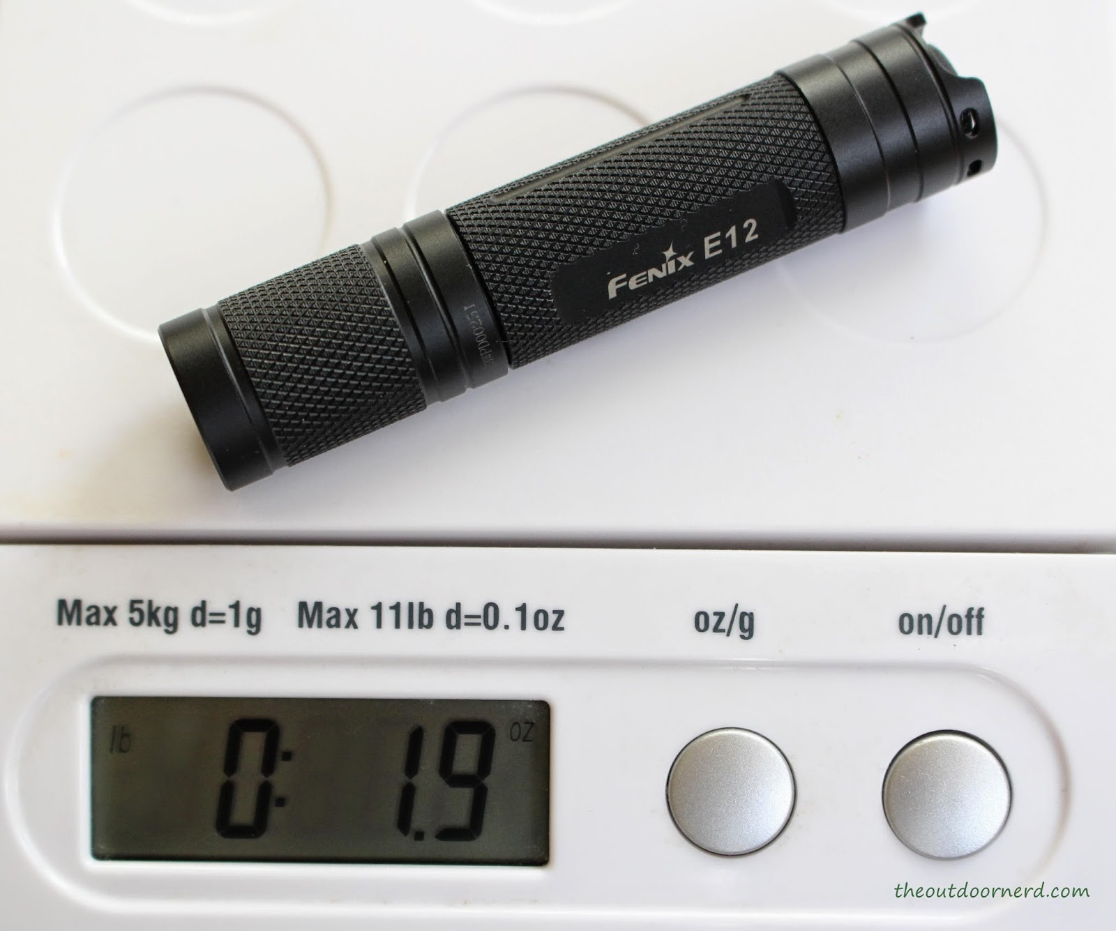 Fenix E12 1xAA EDC Flashlight On Scale
