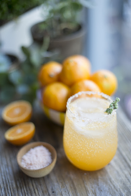 sunny winter cocktail - clementines , tequilla , cayenne