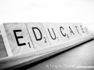 scrabble pieces that spell the word 'educate' sitting on a blackboard
