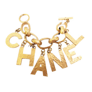 Vintage 1990's gold Chanel charm bracelet with dangling letter charms.