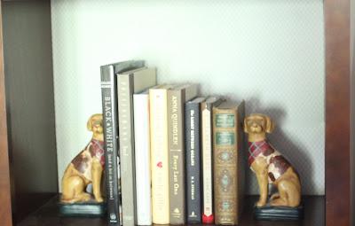 scrapbook paper backing for bookshelves via www.goldenboysandme.com