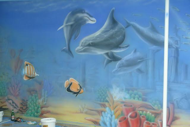 Wystrój ści9an na basenie, mural wykonany na basenie, malowanie rafy koralowej