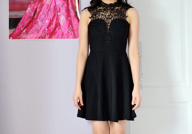 Rowme's high-neck black crochet dress is classy, feminine, and great for special occasions, graduation parties, or other gatherings.
