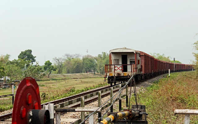 goods train leaving a level crossing