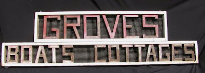 Vintage cottage sign with wooden letters