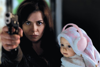 Gwen Cooper (Eve Myles) protects her baby daughter Anwen from the forces of darkness in Torchwood: Miracle Day