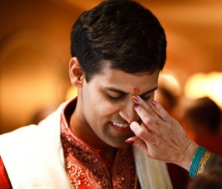 Applying Tilak on the forehead tradition, India