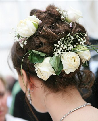 Beautiful and pretty Up do Wedding Hairstyle with white flower design