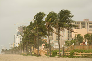 Photo of hurricane and highrise at the beach.