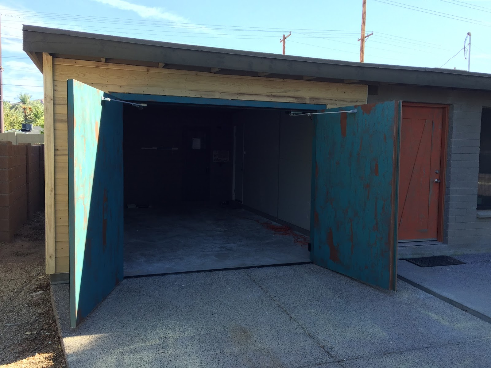 Custom garage doors arizona colorado types of wood used for Build carriage garage doors