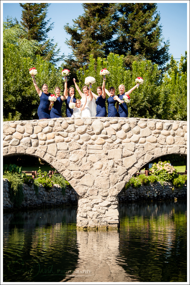 Bridesmaids on bridge over East Lake Ranch