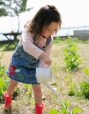beautiful little girl child gardening