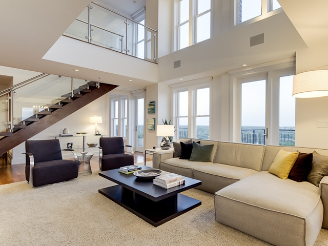 Photo of modern living room with the staircase to upper level