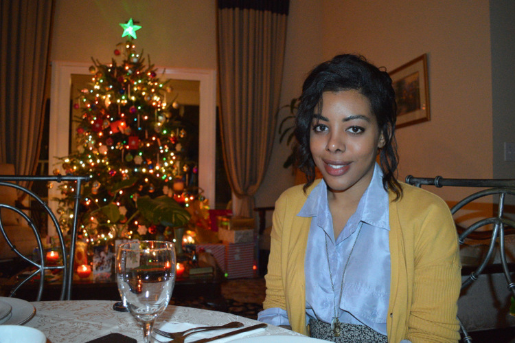 Fashion Blogger Anais Alexandre of Down to Stars with a BDG cardigan and vintage buttondown and skirt at Christmas dinner