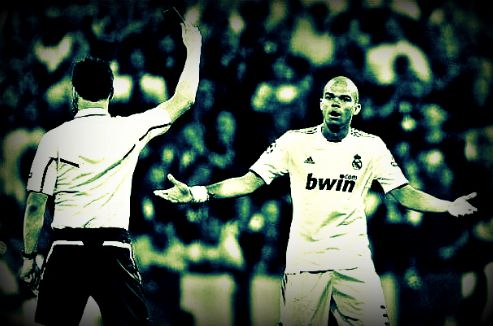 Real Madrid's Pepe from Portugal is shown a red card by the referee during their semifinal first leg Champions League