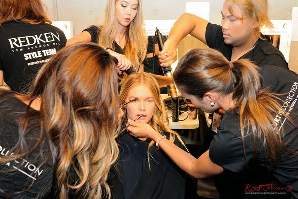 Applying make up, a model in H&MU Backstage for Watson x Watson, MBFWA. Photograph by Kent Johnson.