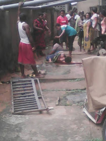 SHAMEFUL: Two married women fall from two story building while fighting(photo)