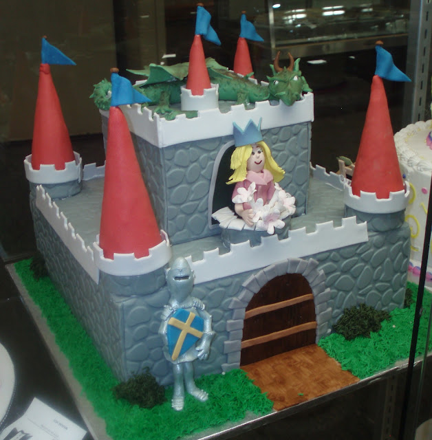 Castle cake with princess, dragon, and knight