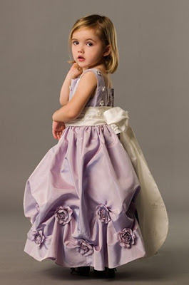 Sweet Little baby girl in beautiful princess gown
