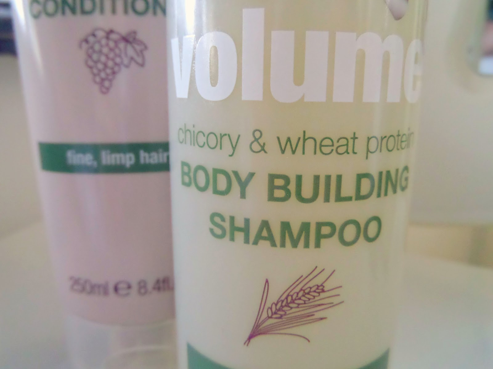 Naked Volume Body Building Shampoo & Weightless Conditioner Bottle