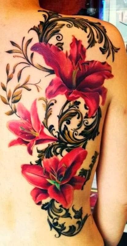 Amazing hibiscus flowers back tattoo.