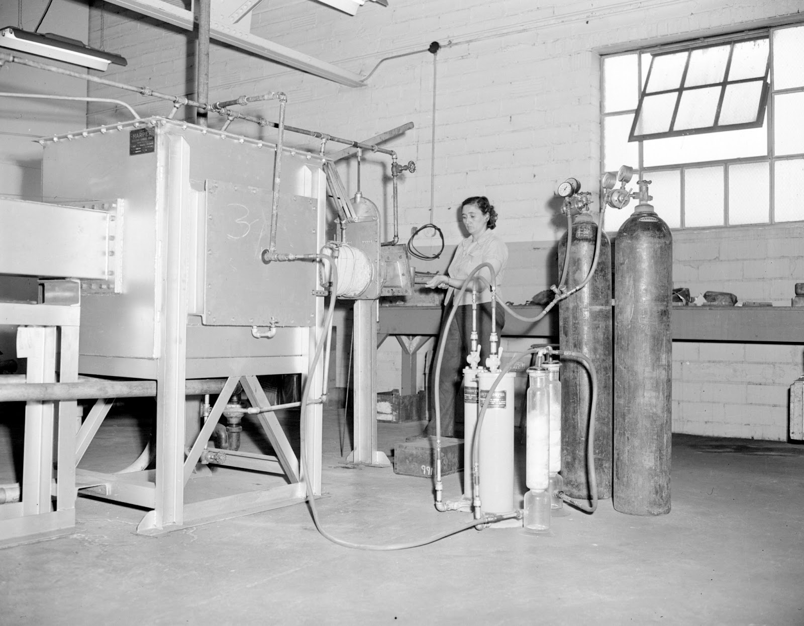 An Unidentified Woman Operating A Piece Of Equipment At The Archer And Smith Tool Company Opened New Metallurgical Laboratory In July 1945